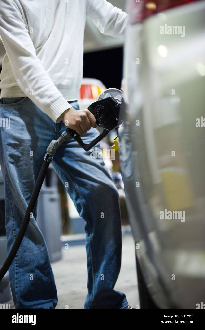 Driver refueling car - Stock Image