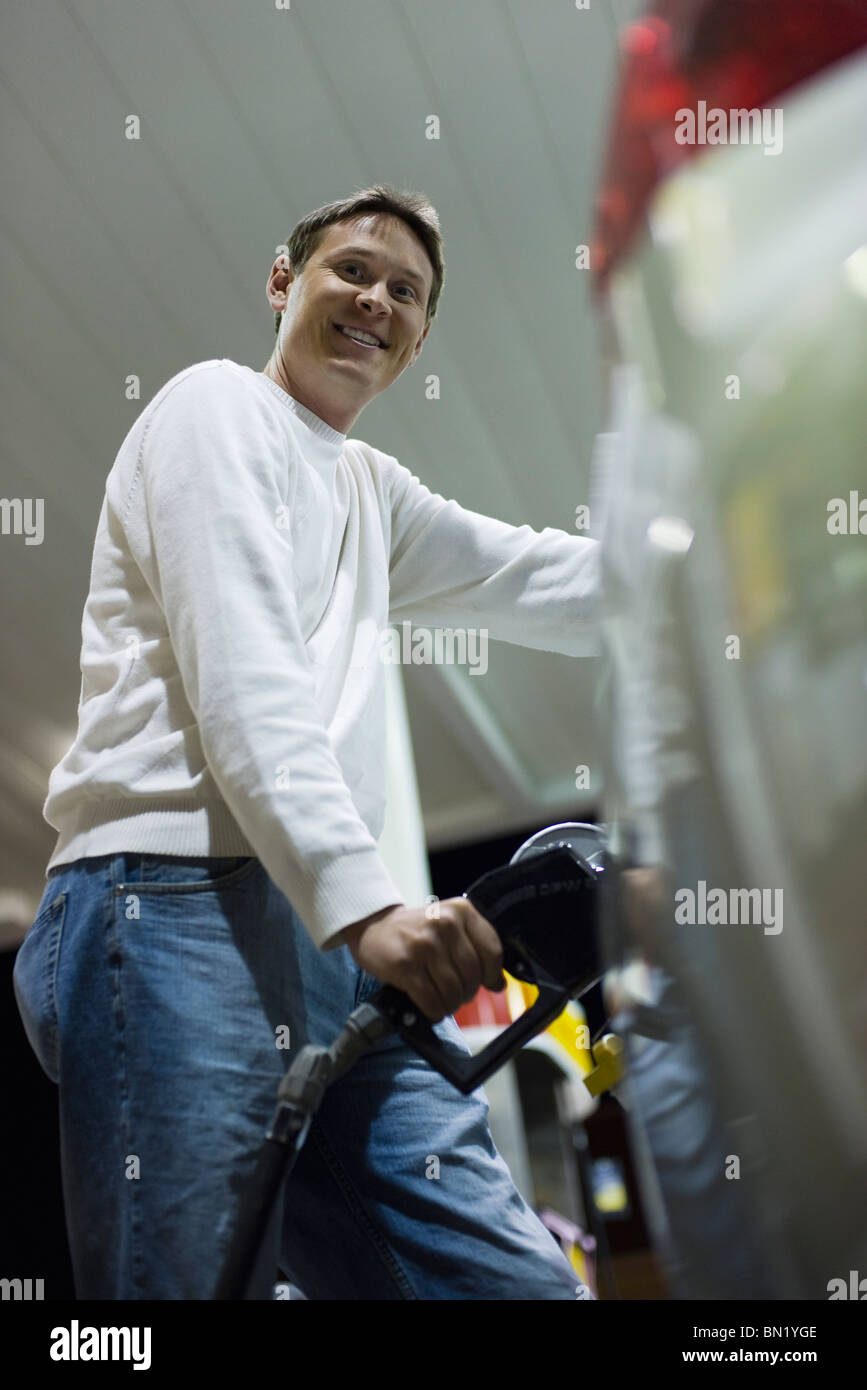 Man refueling at gas station - Stock Image