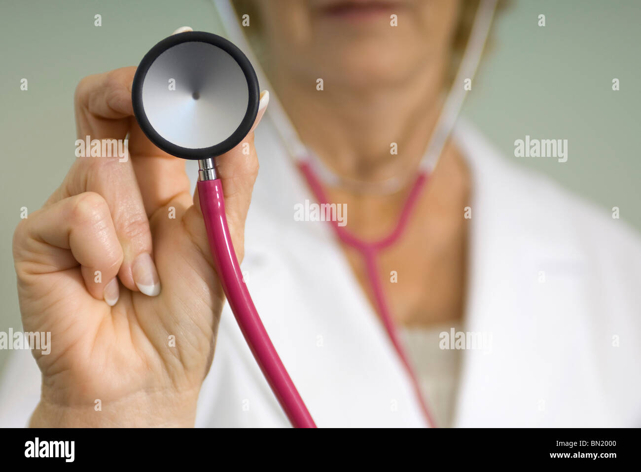 Doctor with stethoscope preparing to give medical exam - Stock Image