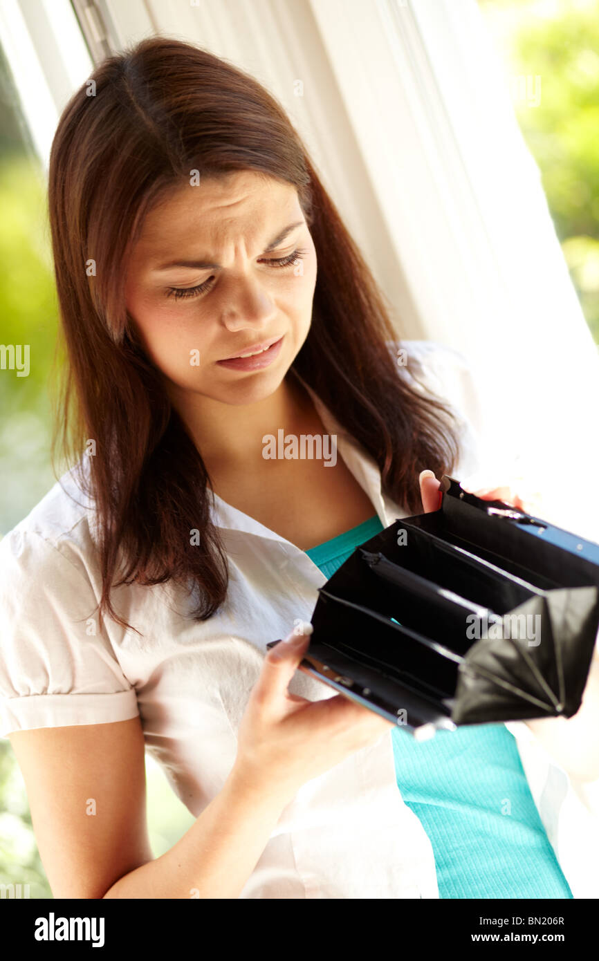 Woman looking in purse - Stock Image