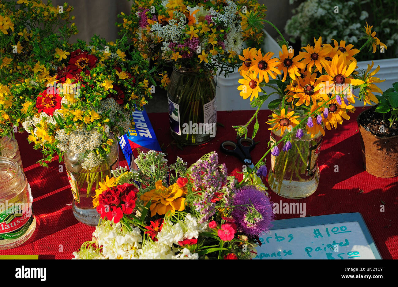 Fresh Market flower bouquets on display at a small town farmers ...