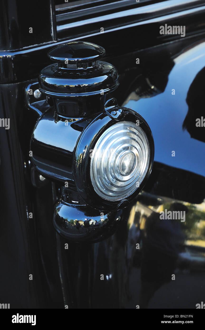 Kerosene lantern on classic Ford Model T with fresnel lens - Stock Image