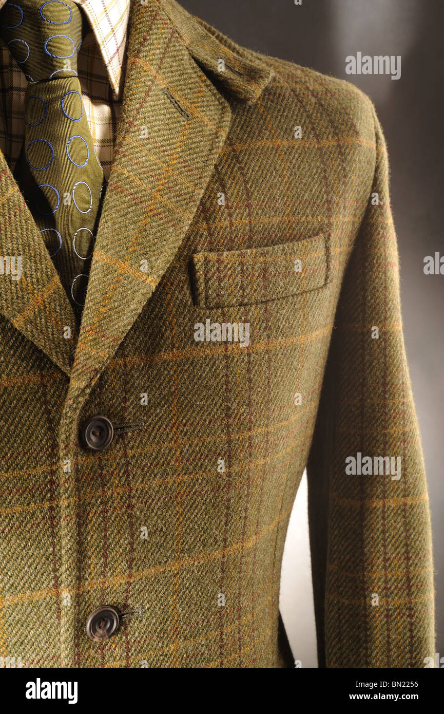 Detail of Traditional Tweed Wool Jacket with Green Tie - Stock Image
