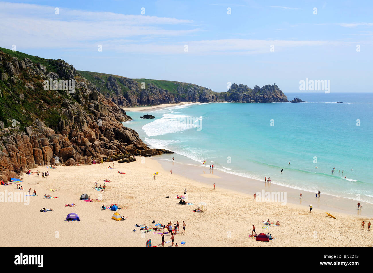 porthcurno beach with logan rock in the distance, porthcurno, cornwall, uk - Stock Image