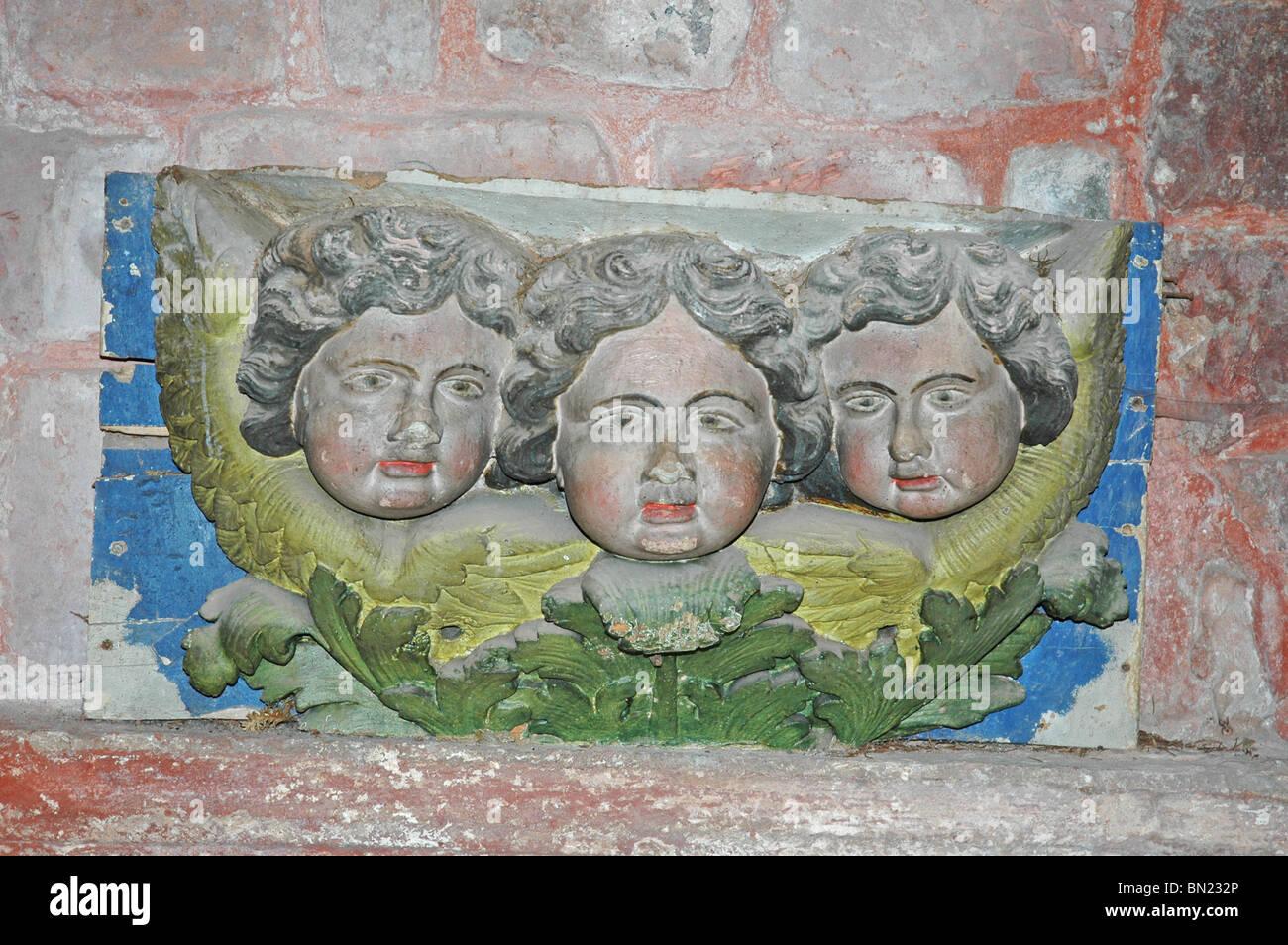 Three Cherubims, sculpted inside the Church of Saint Pierre, Collonges-la-Rouge. - Stock Image