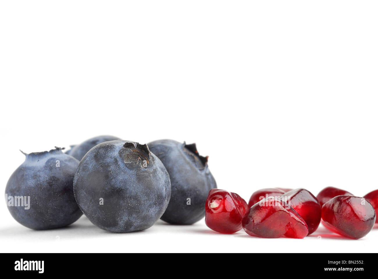 Pomegranate extremely close on white background - Stock Image