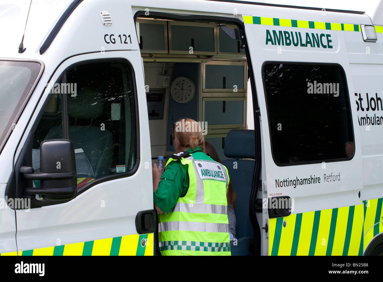 A female paramedic dealing with a patient - Stock Image