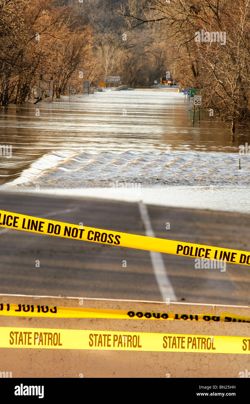 Flood waters of the Minnesota River flow over highway 101 north of downtown Shakopee, Minnesota in March 2010. - Stock Image