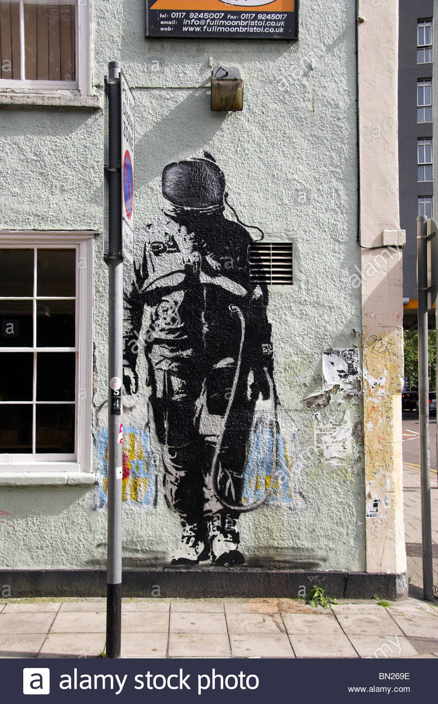 Street art of an astronaut stencil painting on to a building in Bristol, UK. (by graffiti artist SPQR) - Stock Image
