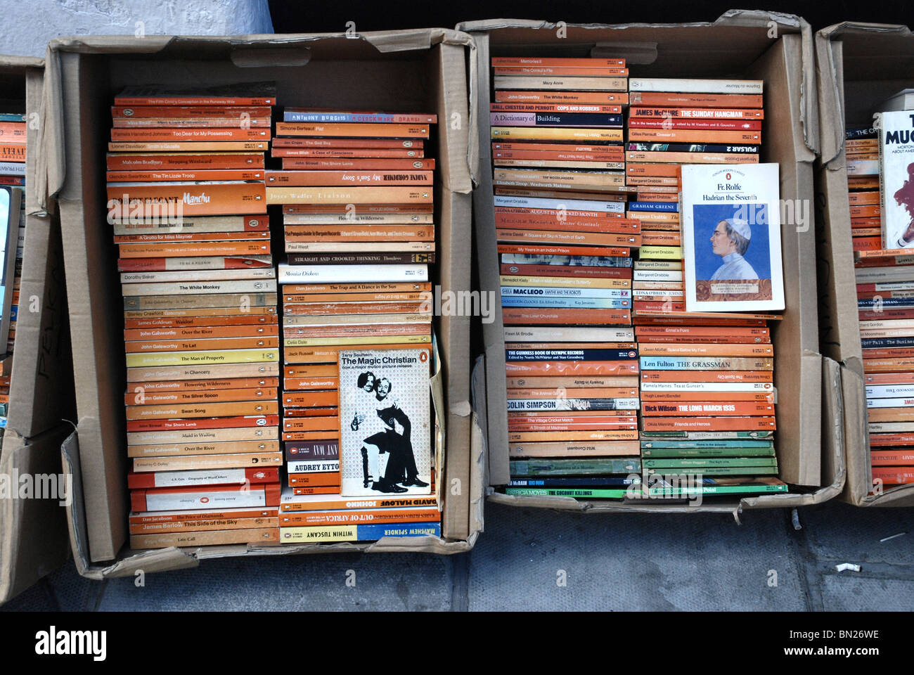 Boxes of Penguin paperbacks outside a secondhand bookshop in Edinburgh. - Stock Image