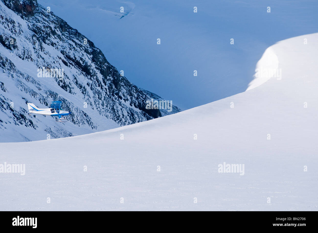 Alaska bush pilot flying his Maule M5 over the Eagle Glacier, Chugach Mountains, Alaska - Stock Image