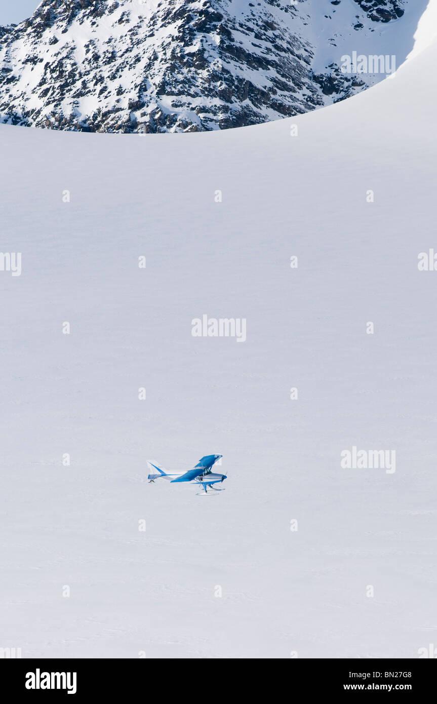 Maule M5 flying over the Eagle Glacier, Chugach Mountains, Alaska - Stock Image
