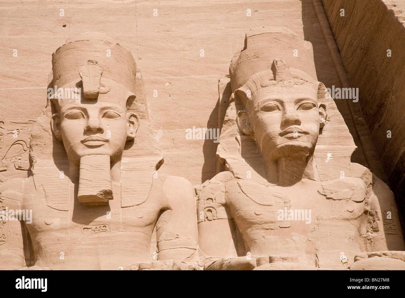 Statues of Ramses 11 outside the entrance of Abu Simbel - Stock Image