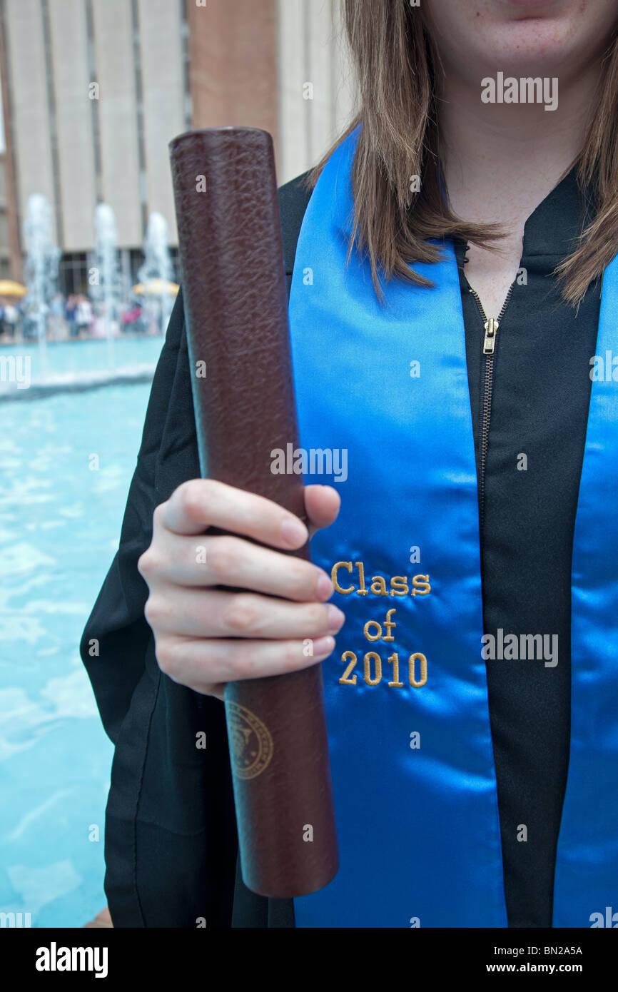 Kalamazoo, Michigan - A graduate of the Class of 2010 at Western Michigan University holds her diploma. - Stock Image