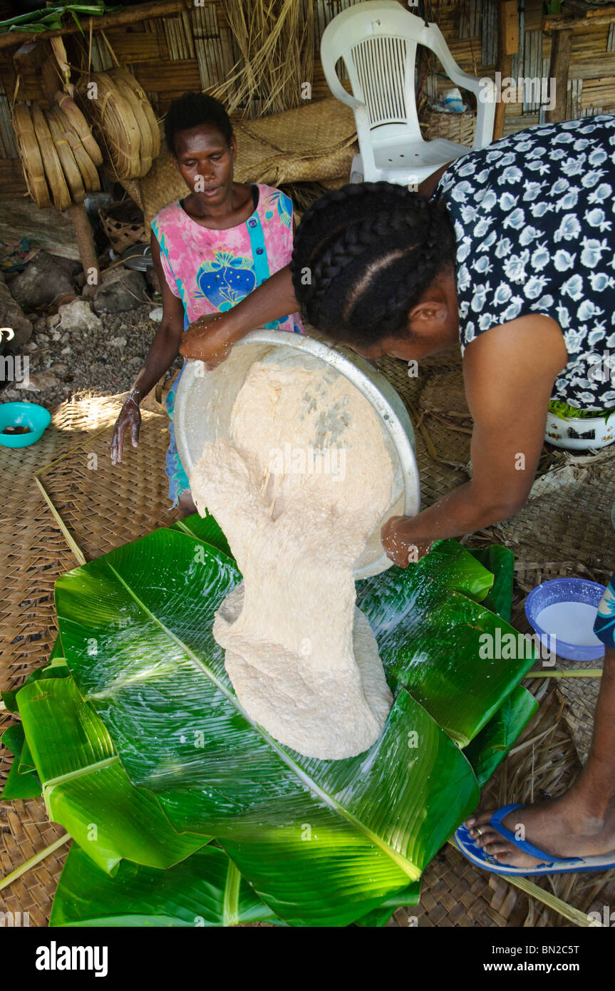 Traditional food preparation by south Pacific islanders. Pls click for more info. - Stock Image