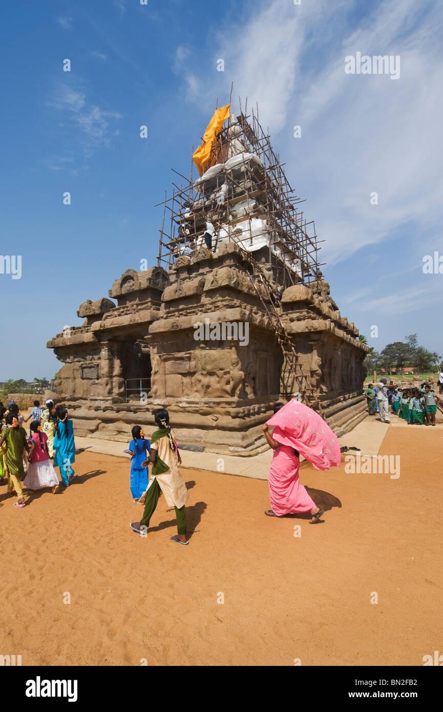 India Tamil Nadu Mamallapuram schoolboys visiting the Shore temple declared humanity's estate by the UNESCO organization Stock Photo