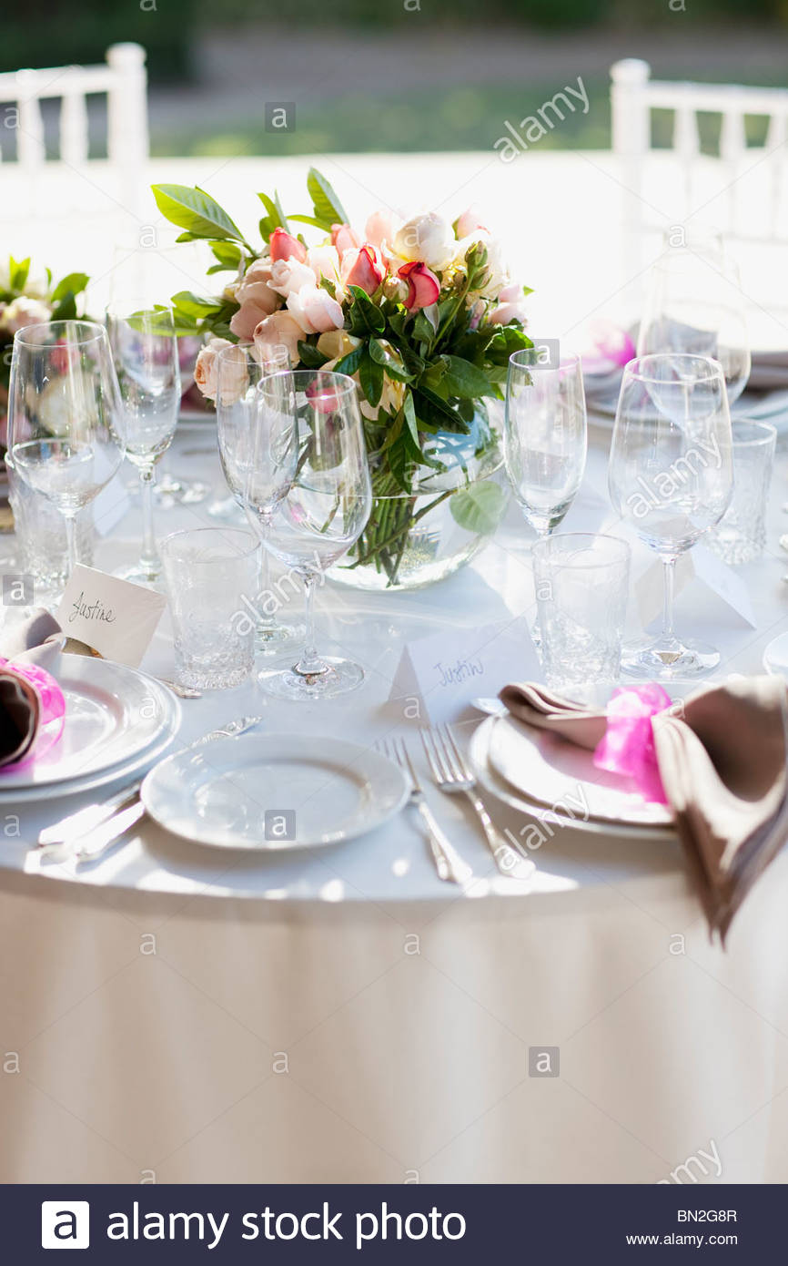 Close up of place setting at wedding reception - Stock Image