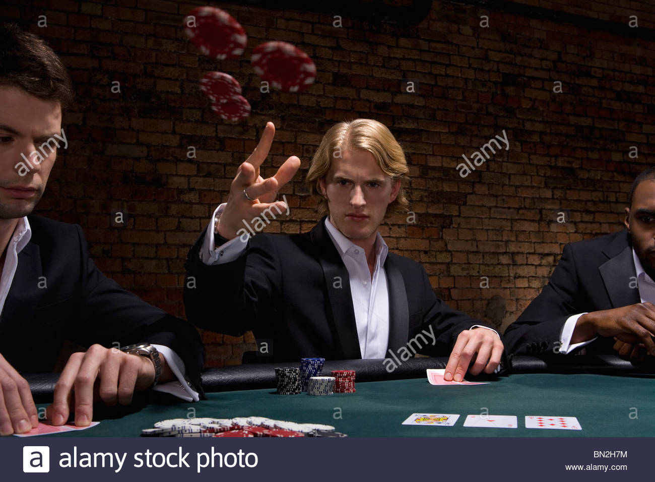 Man throwing poker chips in casino - Stock Image