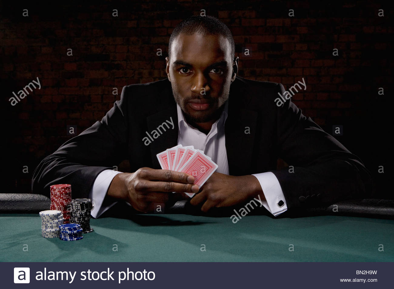 Man playing poker in casino Stock Photo