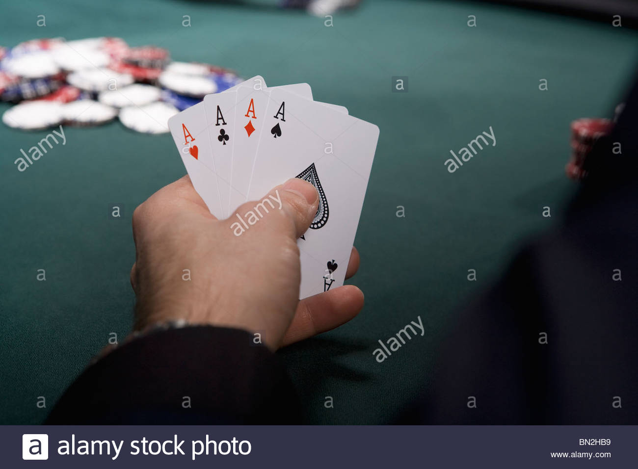 Man with four aces in casino - Stock Image