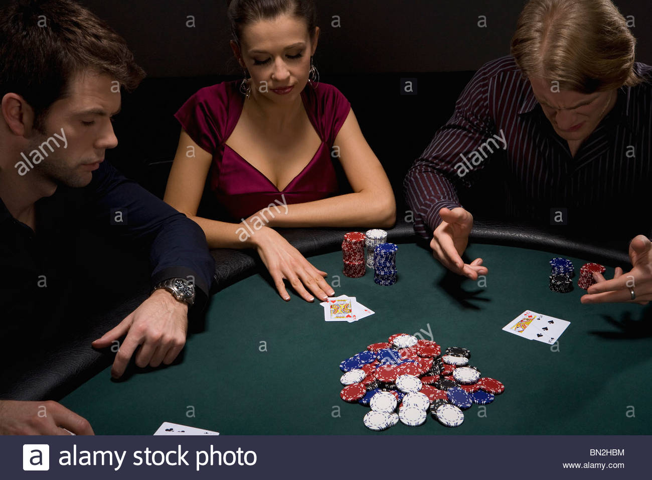 Frustrated man playing cards in casino - Stock Image