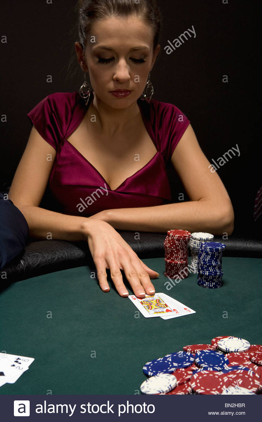Woman playing blackjack in casino Stock Photo