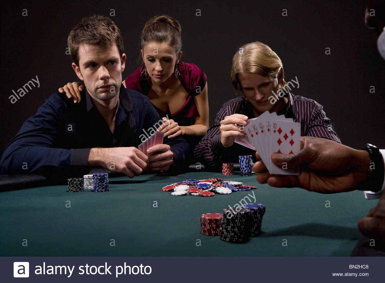 People playing poker in casino - Stock Image
