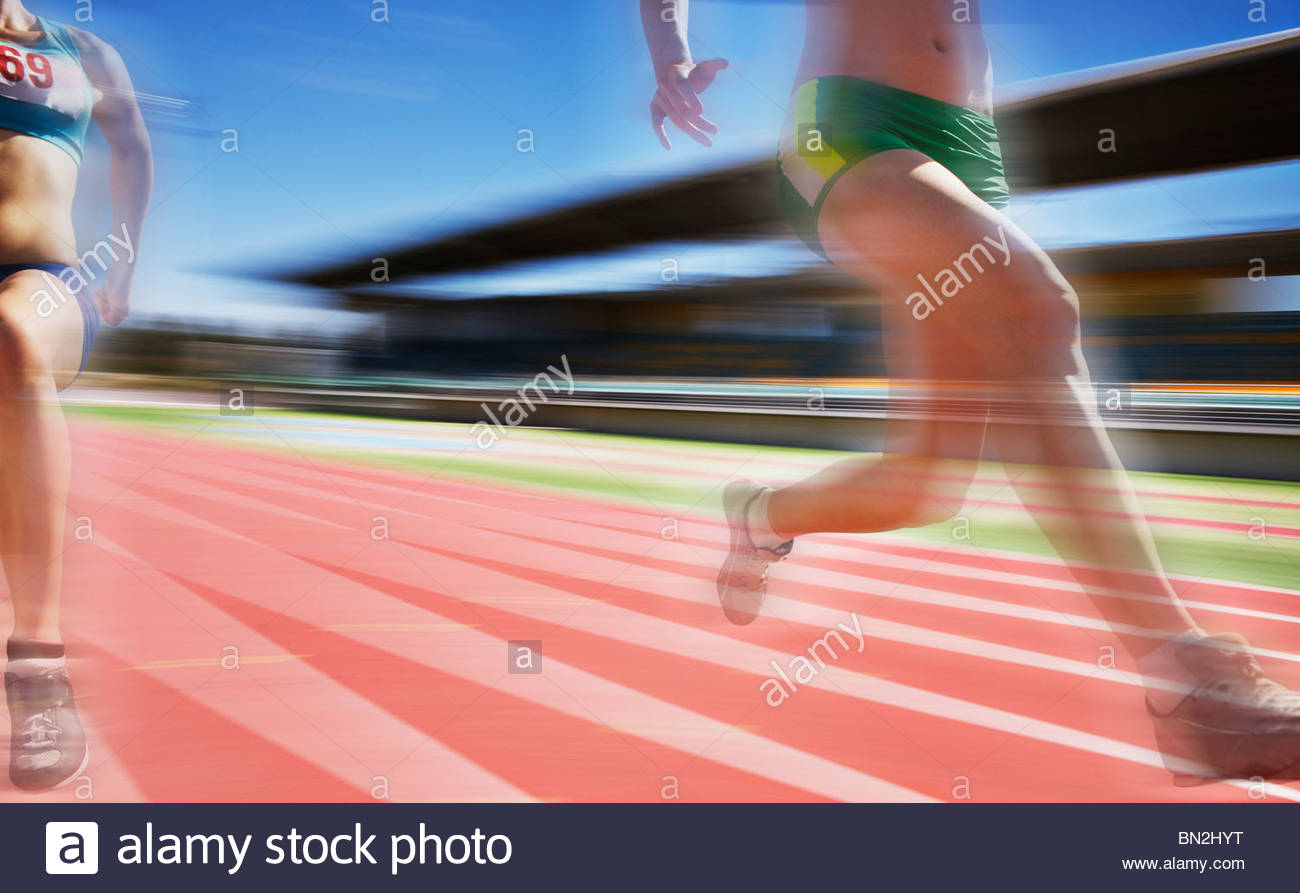 Runners competing on track - Stock Image