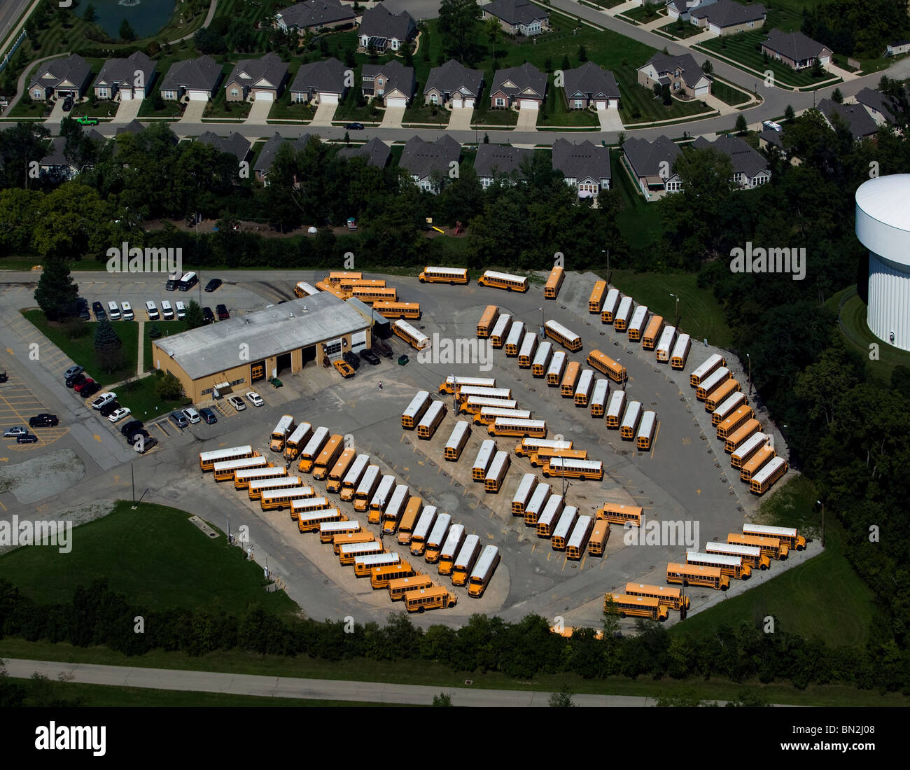 aerial view above school buses transportation yard Indiana - Stock Image