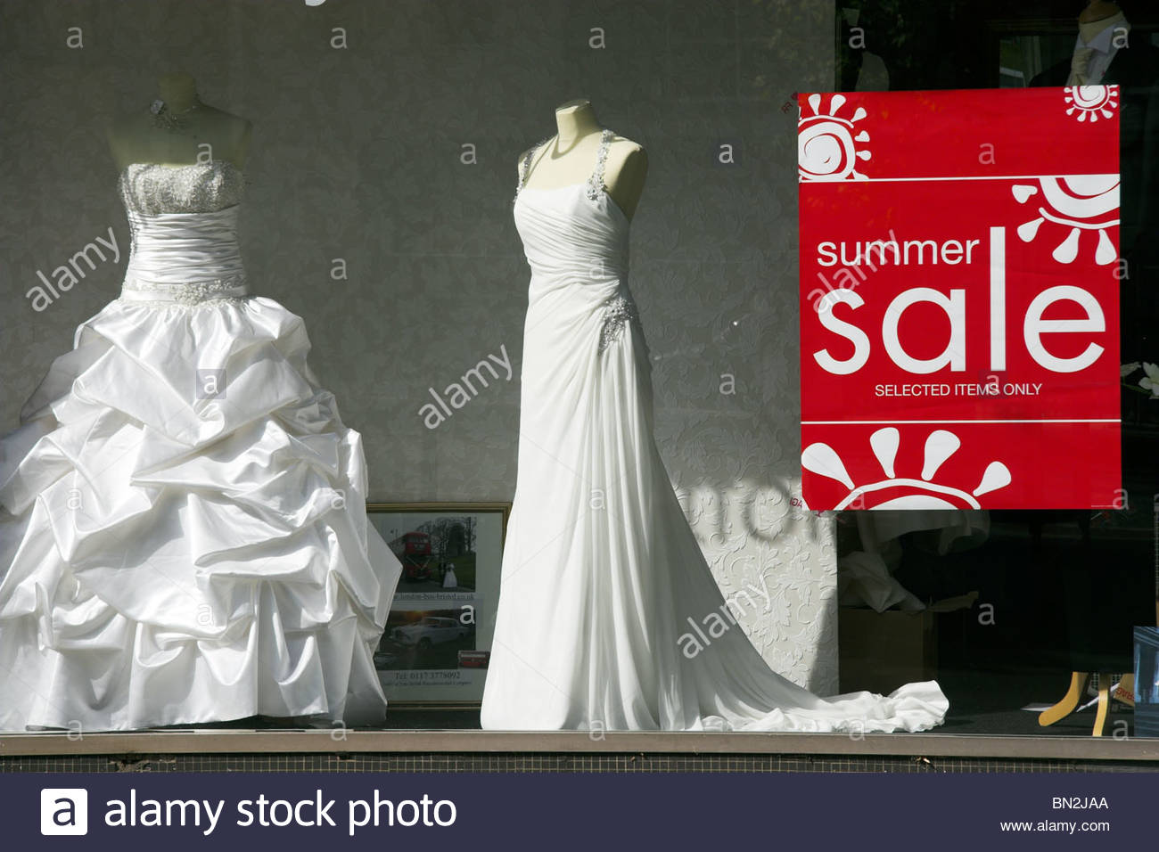 Wedding dress clothing shop summer sale, seen thru a shop window ...