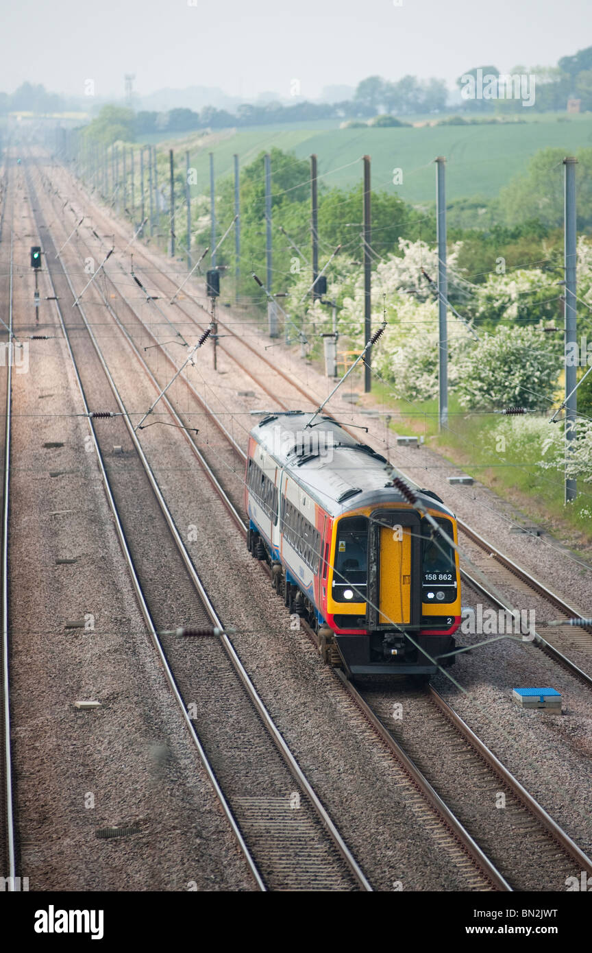 East Midlands Trains passenger train class 158 travelling at speed through the english countryside. - Stock Image