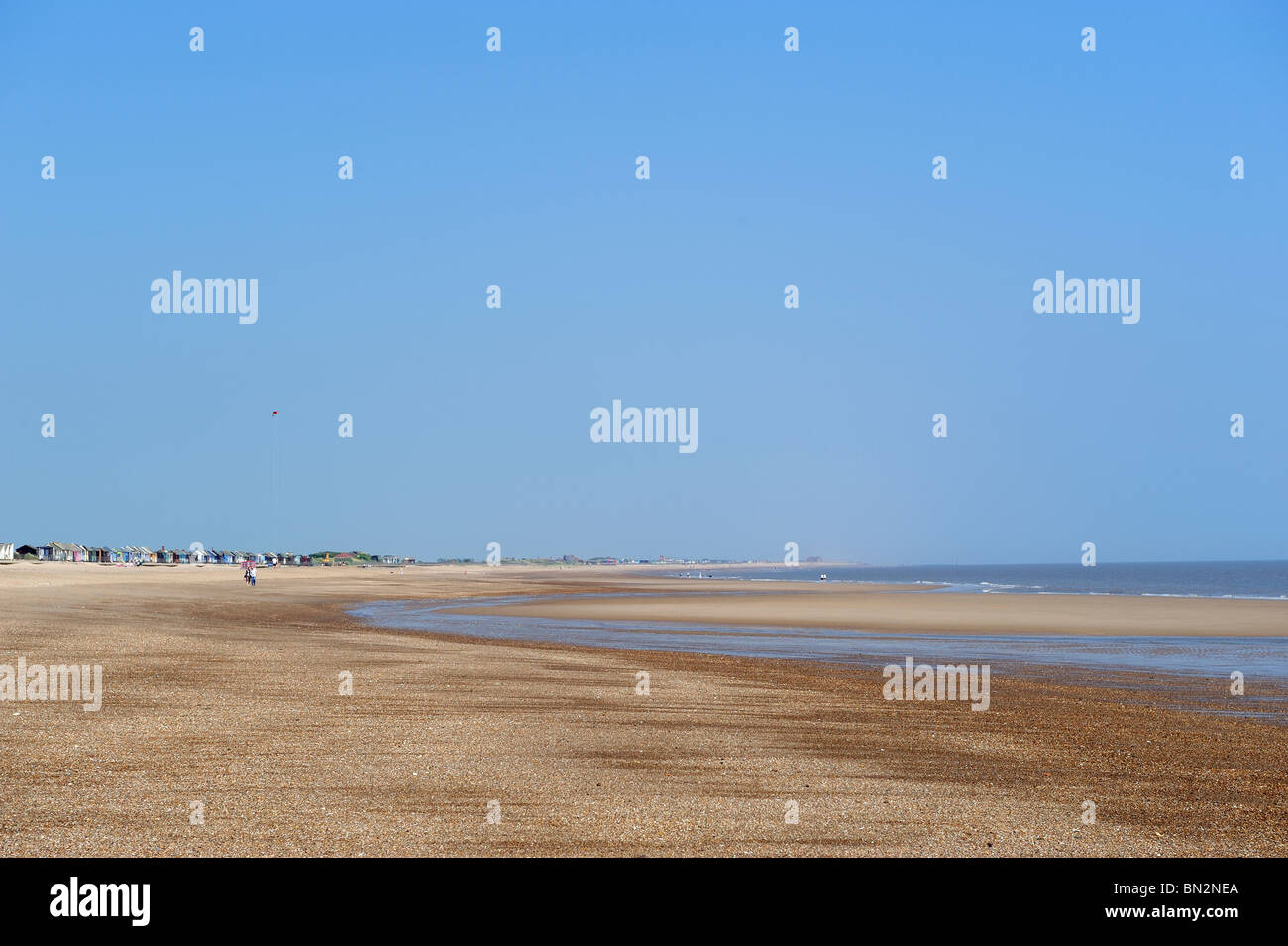 Deserted Beach on a Summer Morning , Trusthorpe , Lincolnshire with beach huts - Stock Image