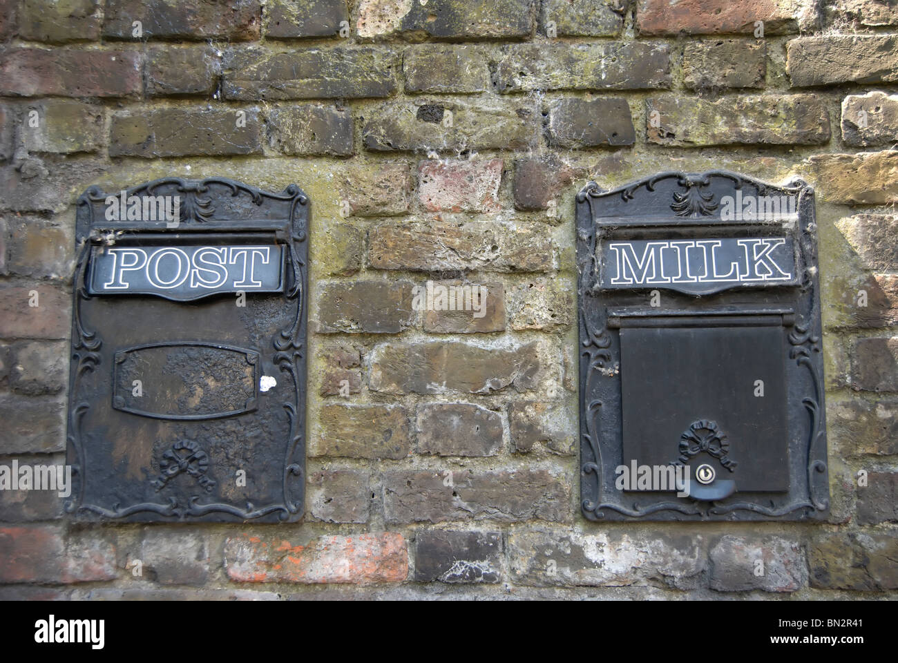 wall boxes for post and milk, outside montrose house in petersham, surrey, england - Stock Image