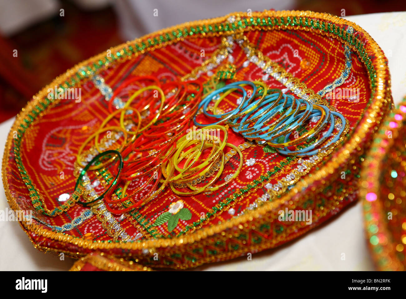 bangles in a basket - Stock Image