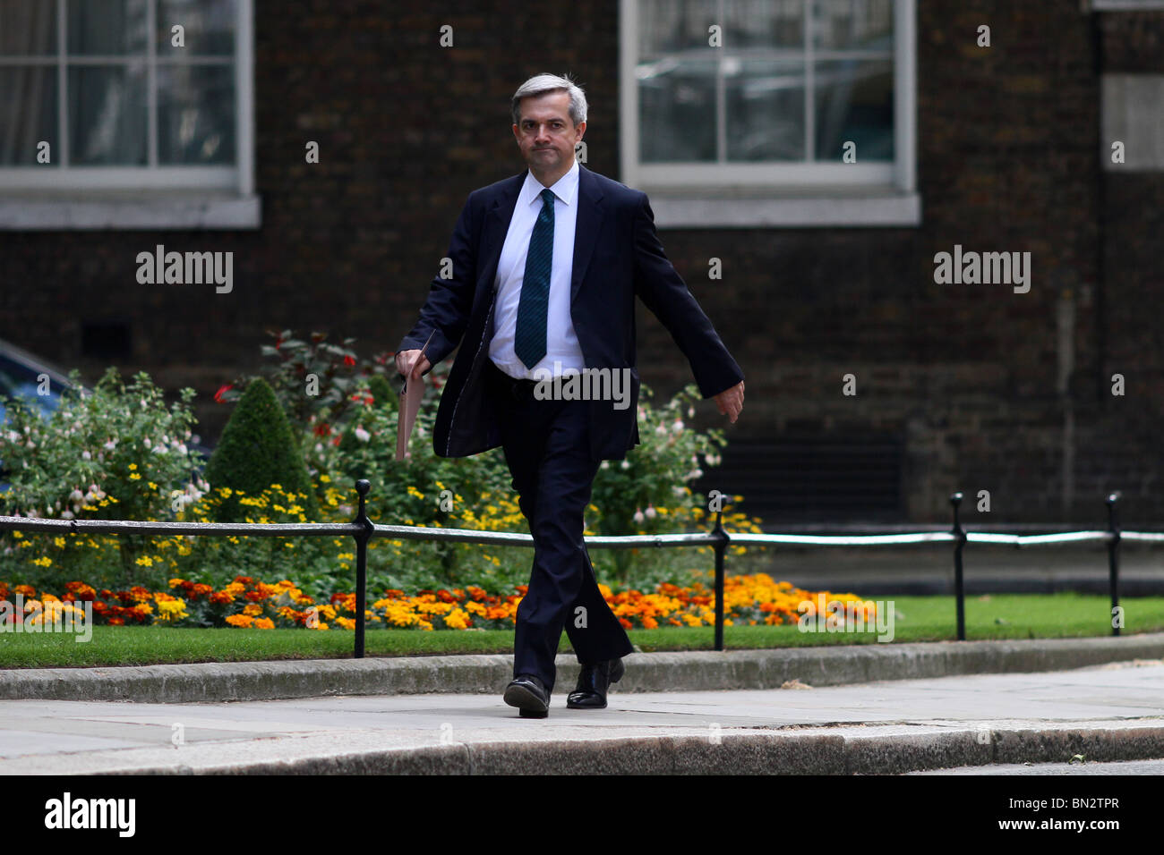 Budget Day . . 22.06.10 Chris Huhne, secretary of state for energy and climate change, arriving for cabinet. - Stock Image