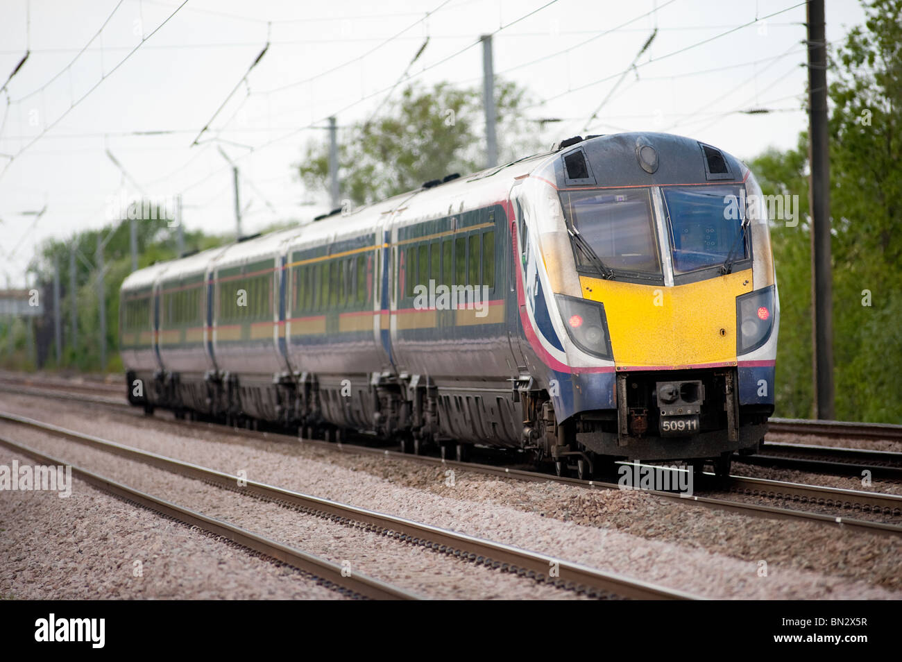 First Hull trains passenger train class 180 travelling at speed through the english countryside. - Stock Image