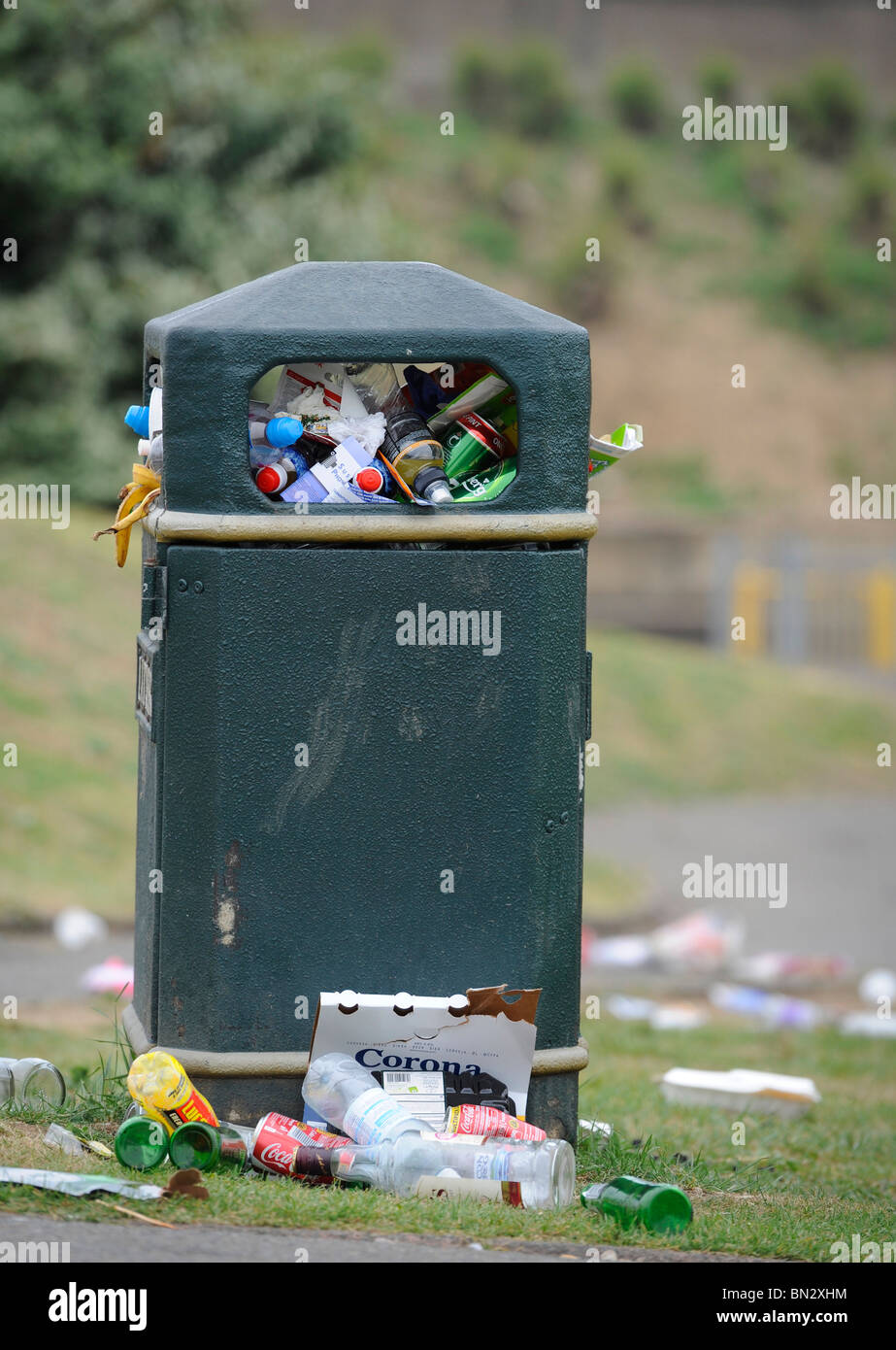 A bin over flowing with rubbish in Seaford, East Sussex, UK. - Stock Image
