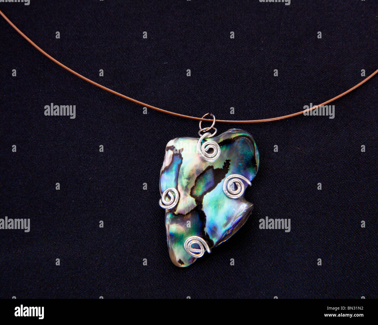 Single Paua shell from New Zealand made into a necklace / pendant - Stock Image