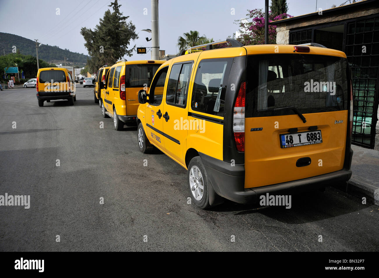 People Carrier Taxis Lined Up On Taxi Rank Torba Turkey Stock Photo