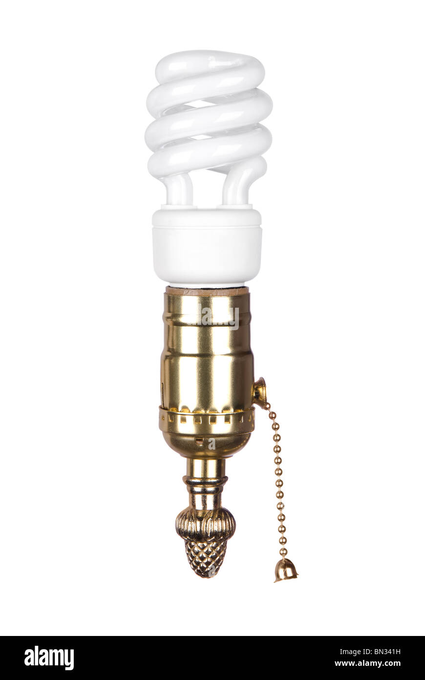 An energy efficient spiral light bulb and brass light socket with pull chain isolated on white. - Stock Image
