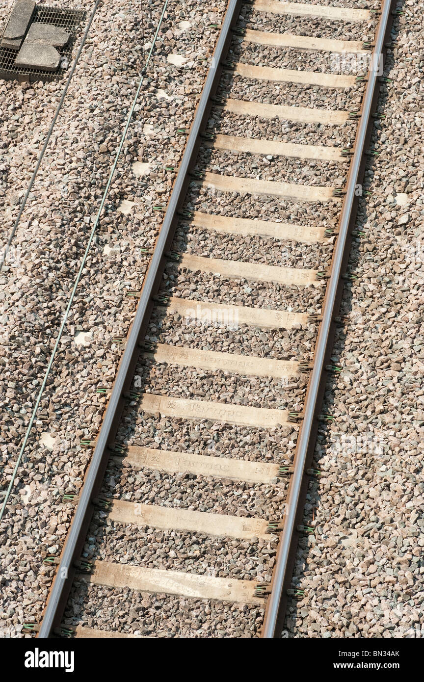 Looking down on to railway track, ballast and sleepers. - Stock Image