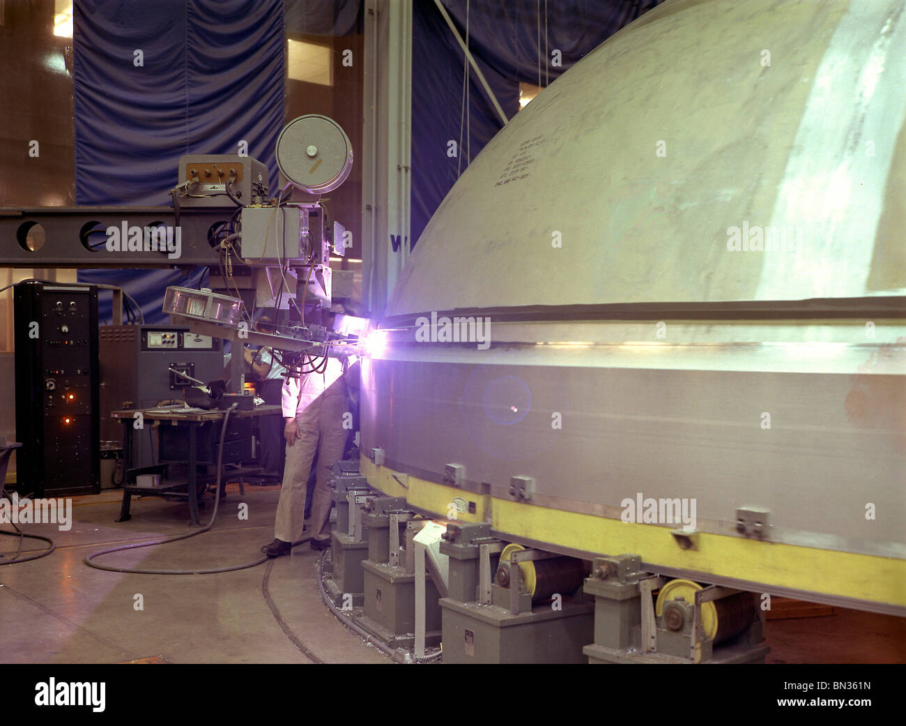 welding the Y-ring to the S-IC stage bulkhead and the fuel tank for the Saturn V SA-502 launch vehicle - Stock Image