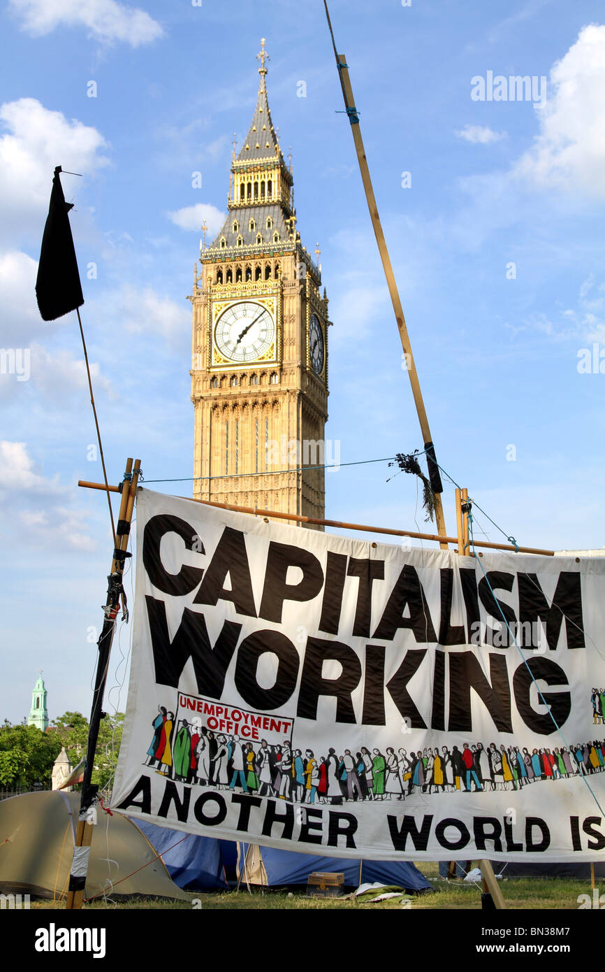 Parliament Square Peace Camp and Big Ben with anti Capitalism demonstration banner, Capitalism isn't working, London, Stock Photo