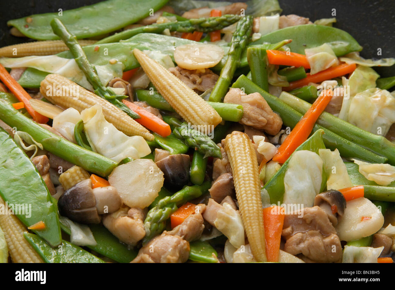 Thai chicken and vegetable stir fry stock photos thai chicken and chinese vegetable and chicken stir fry in wok close up stock image forumfinder Image collections