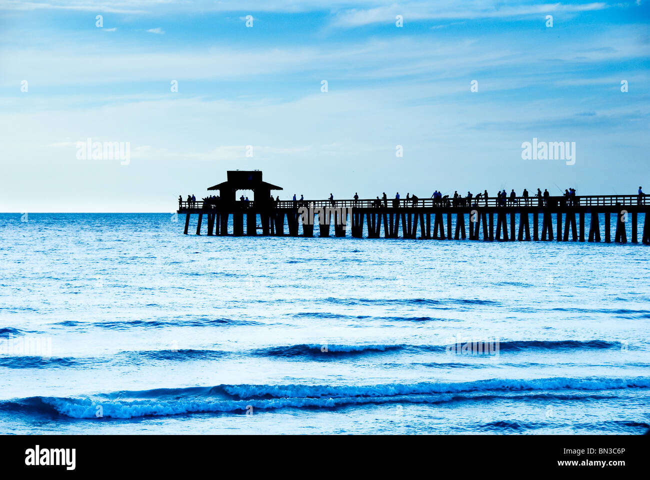 People fishing from Naples pier in Gulf of Mexico, Naples, Florida, USA - Stock Image