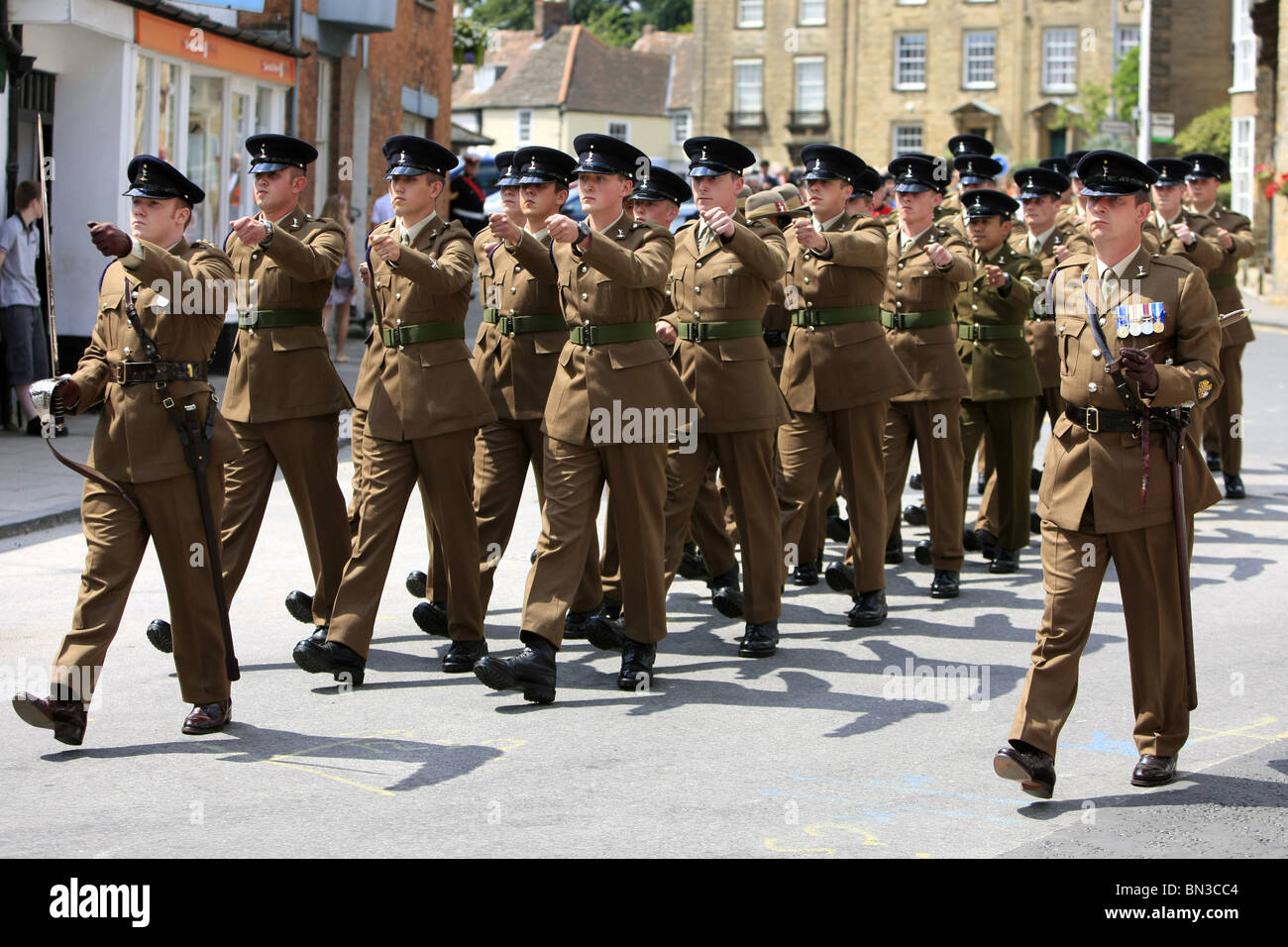 UK Armed Forces Day Parade British Army Soldiers from the Signals Regiment Marching through Sherborne Dorset - Stock Image