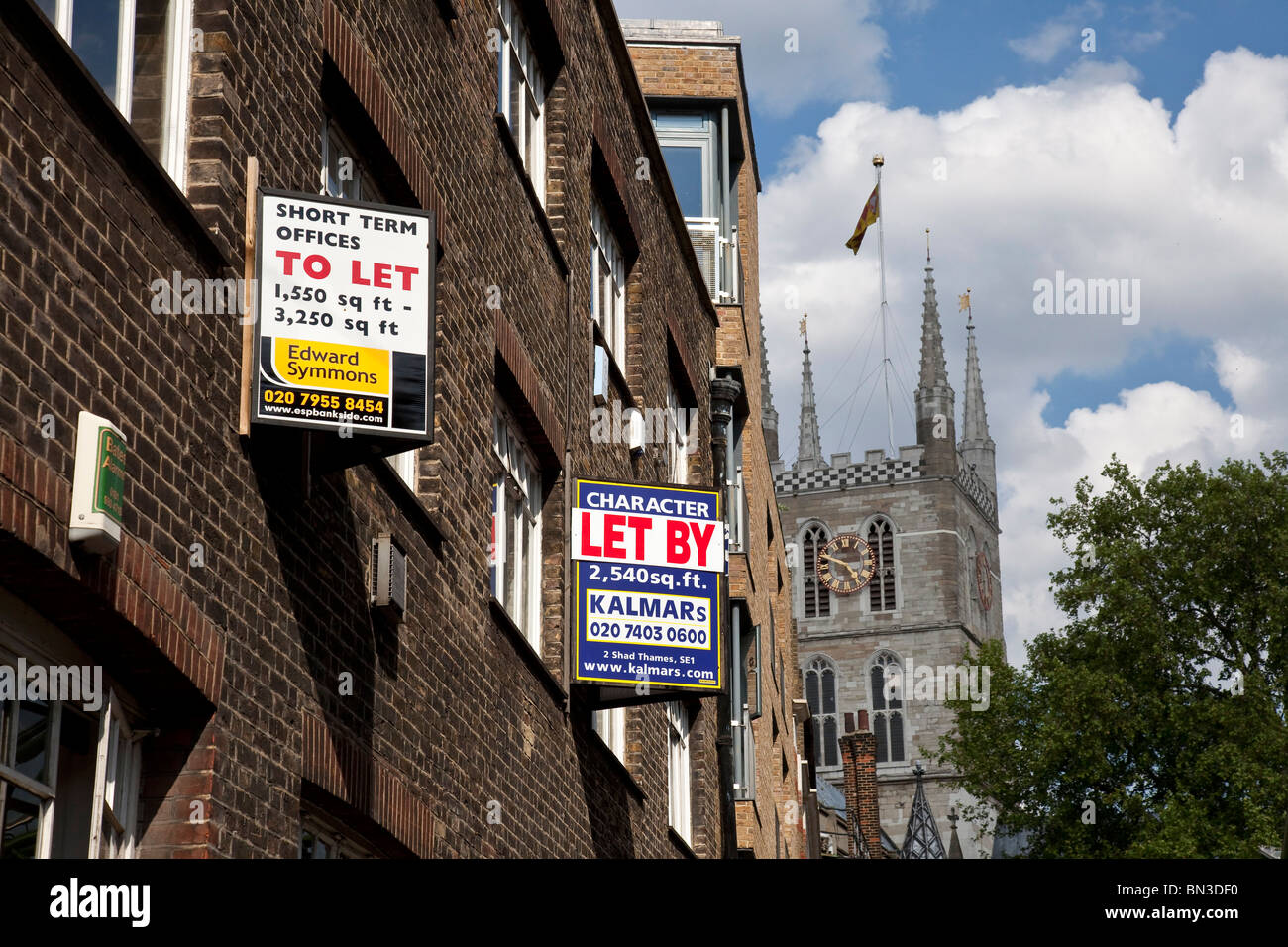 Offices to let in the city centre of London, at the back a typical British cathedral - Stock Image