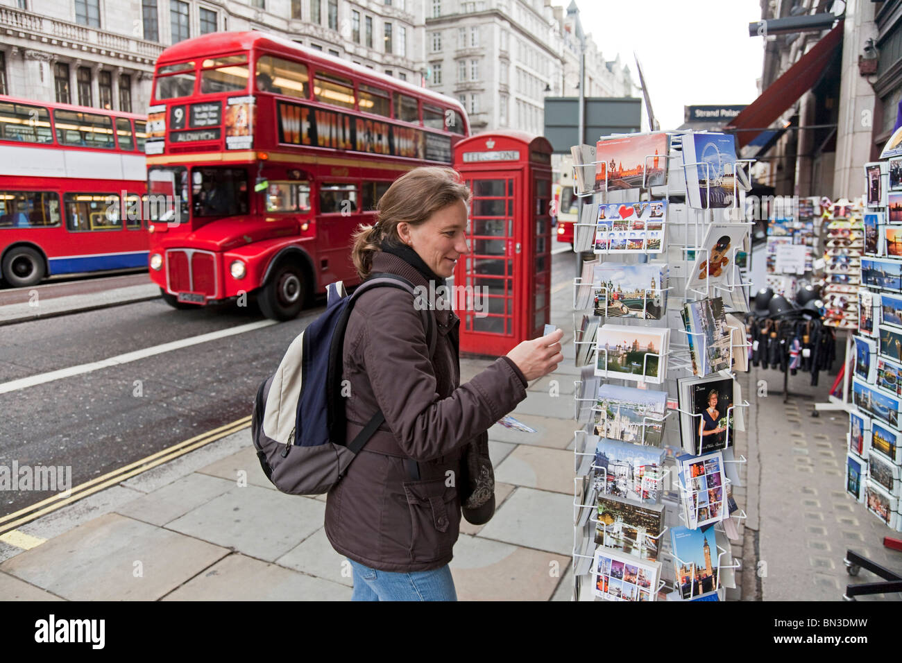 Tourist byuing postcards in London - Stock Image