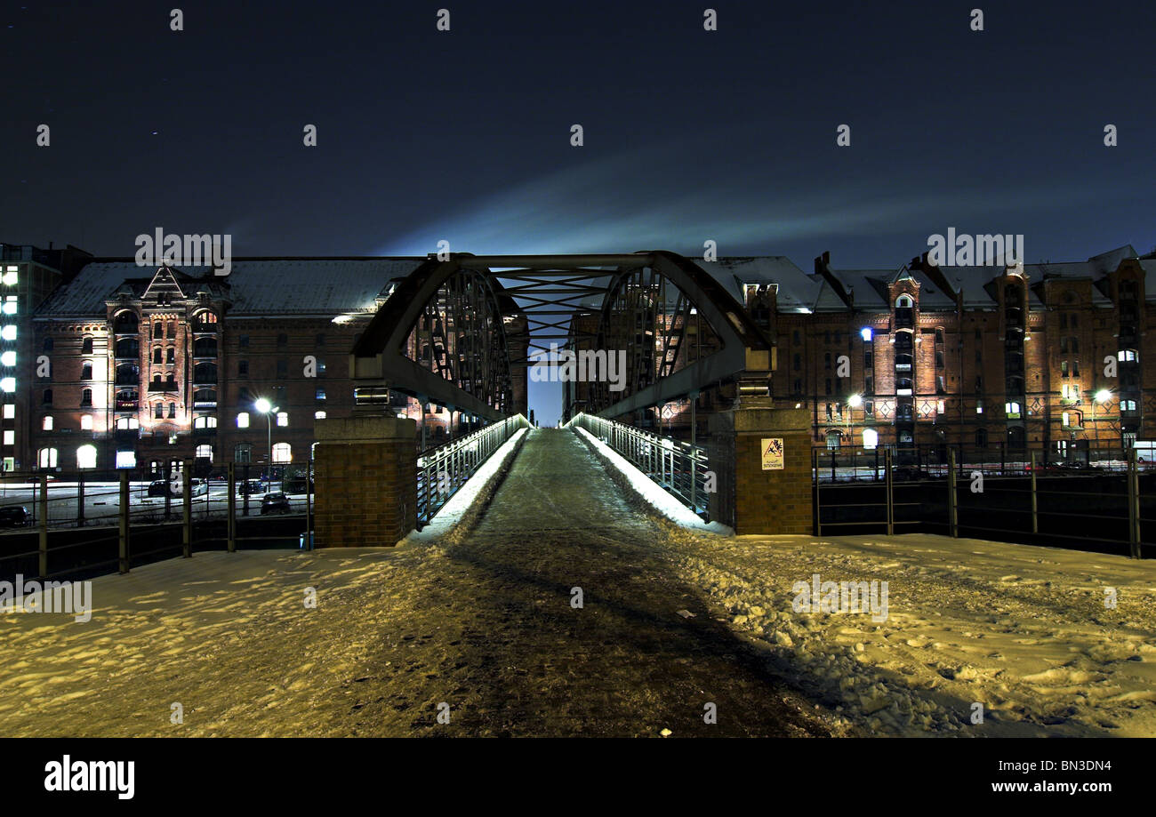 Bridge in the old warehouse district (Speicherstadt) at night, Germany Stock Photo