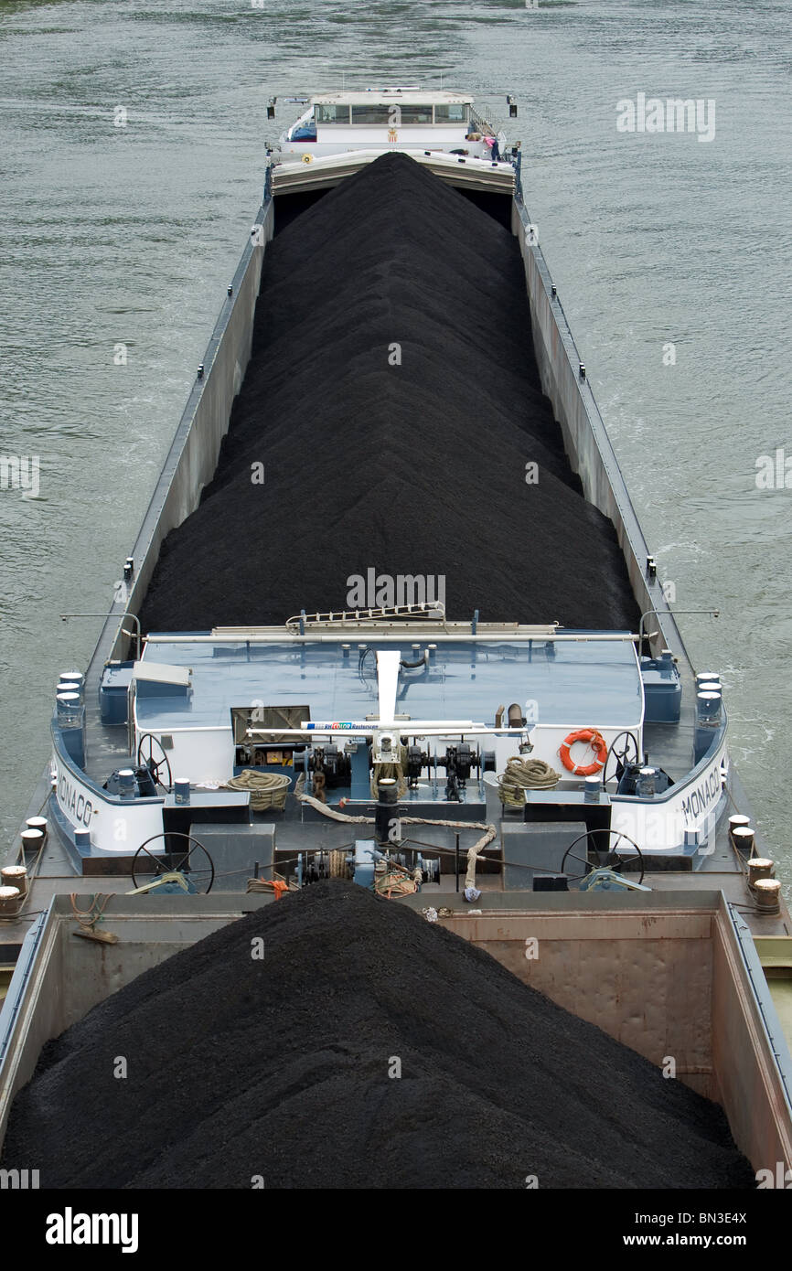 Towboat and coal on barges, Rhineland-Palatinate, Germany, elevated view - Stock Image